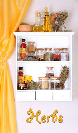Variety herbs on kitchen shelves photo