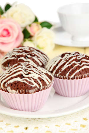 Sweet chocolate cupcakes close up photo
