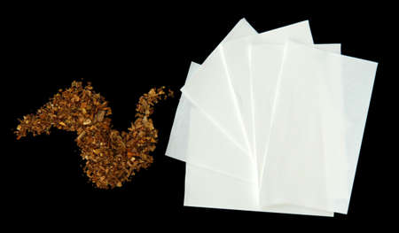 rolling paper: Tobacco and rolling paper, isolated on black Stock Photo