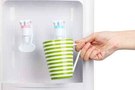 Woman filling cup at water cooler Stock Photo - 20799374