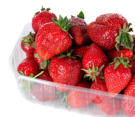 Strawberries in plastic box isolated on white photo