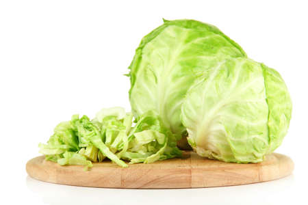 nutriment: Green cabbage sliced on cutting board, isolated on white