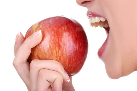 apple bite: woman with apple isolated on white