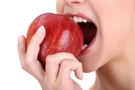 hands in mouth: woman with apple isolated on white
