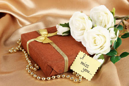 miss you: Romantic parcel on gold cloth background