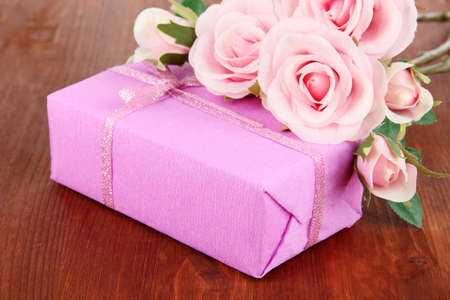 Romantic parcel on wooden background photo