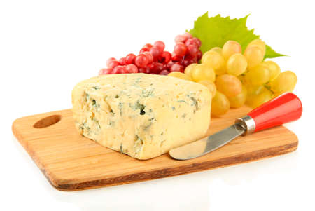 Tasty blue cheese and grape on cutting board, isolated on white photo