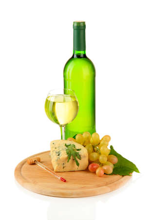 Wine, tasty blue cheese and grape on cutting board, isolated on white photo