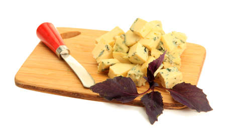 Tasty blue cheese on cutting board, isolated on white photo