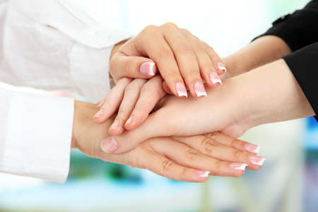 United hands, on bright background Stock Photo - 20829048