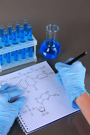 Scientist working at laboratory on gray background Stock Photo - 20829693