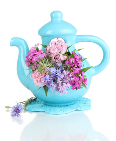 Beautiful bouquet in blue teapot isolated on white photo