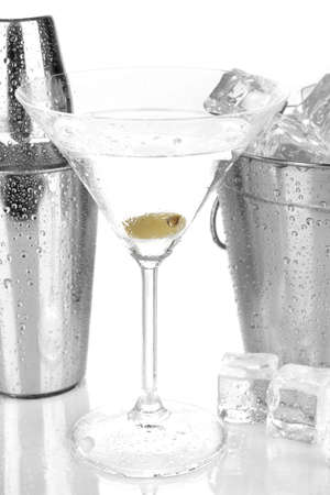 refrigerate: Metal ice bucket and shaker and cocktail isolated on white