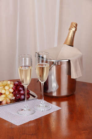 special steel: Champagne and glasses on round table on cloth background