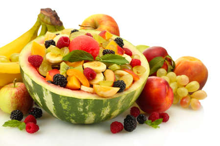 fresh fruits salad in watermelon, fruits and berries, isolated on white photo