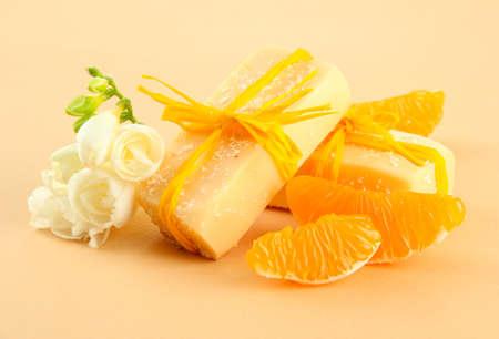 Natural fruit handmade soap, on beige background photo