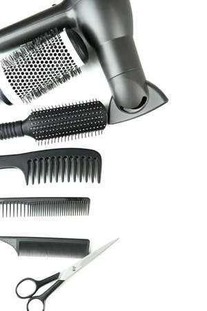 shears: Comb brushes, hairdryer and cutting shears, isolated on white