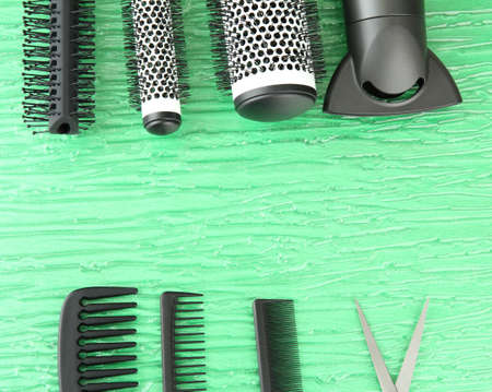 Comb brushes, hairdryer and cutting shears,on color background Stock Photo - 20929988