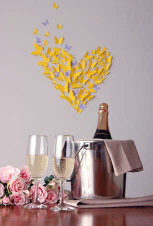 Champagne and glasses on round table on room  background photo