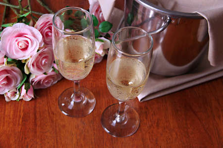 Champagne and glasses on round table close-up photo