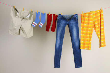 line: Laundry line with clothes on wall background