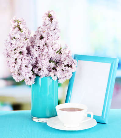 Beautiful lilac flowers on table in room Stock Photo - 20956383