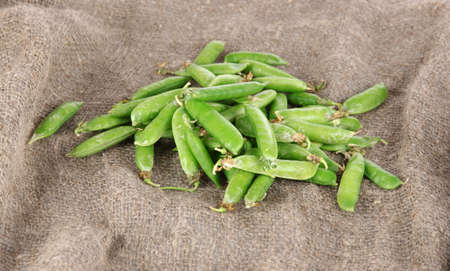 bagging: Green peas on bagging background Stock Photo