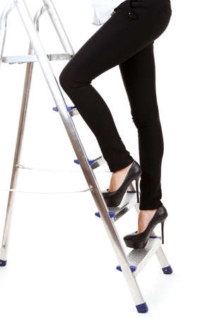 Woman climbing up ladder isolated on white photo