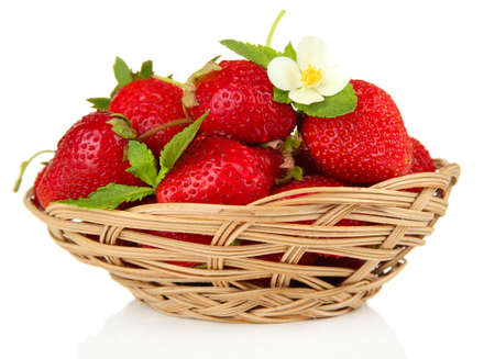 Ripe sweet strawberries in basket, isolated on white photo