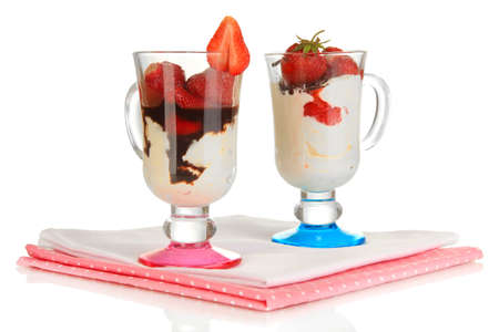 Delicious strawberry desserts in glass vase isolated on white photo