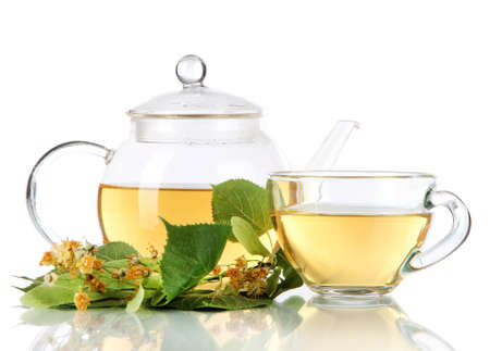 medicinal herb: Kettle and cup of tea with linden isolated on white