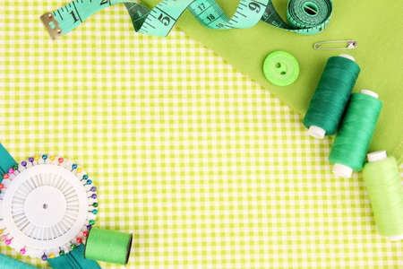 sewing supplies: Sewing accessories and fabric close-up