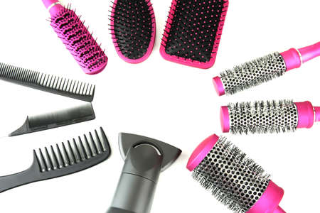 Comb brushes, hairdryer and cutting shears, isolated on white Stock Photo - 20968222