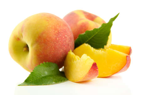 velvety: Ripe sweet peaches with leaves, isolated on white