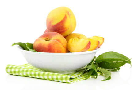 velvety: Ripe sweet peaches in bowl, isolated on white