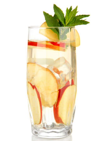 Glass of fruit drink with ice cubes isolated on white photo