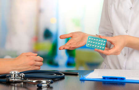 Gynecologist appoints hormone pills patient Stock Photo