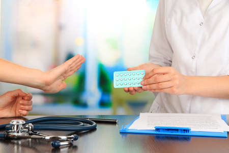 appoints: Gynecologist appoints hormone pills patient Stock Photo