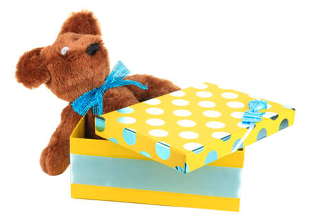 contrasty: Yellow gift box with toy isolated on white Stock Photo
