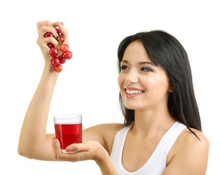 Girl with fresh cherries and juice isolated on white Фото со стока