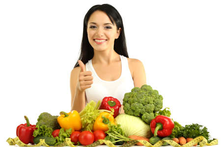 Girl with vegetables isolated on white photo