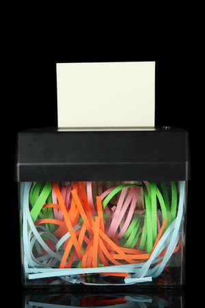 shredder machine: Paper shredder machine, isolated on black Stock Photo