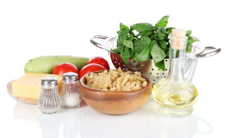 Ingredients for cooking pasta isolated on white photo