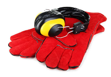Protective gloves and headphones isolated on white Stock Photo - 20999647