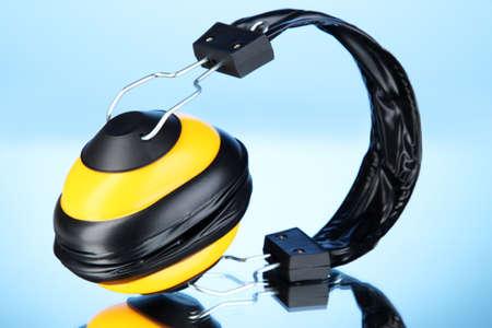 onslaught: Headphones on blue background