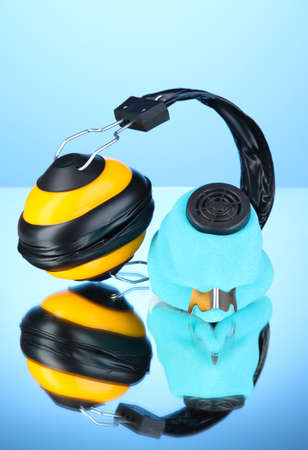 Respirator and headphones on blue background photo
