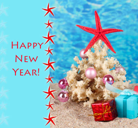beach happy new year: Conceptual photo: Celebrating Christmas at beach Stock Photo