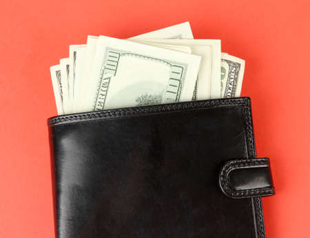 money falling: Wallet with hundred dollar banknotes, on color background
