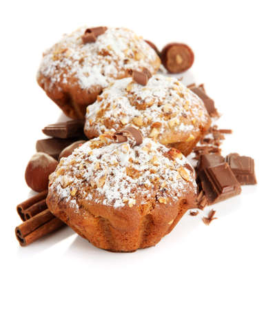 Tasty muffin cakes with powdered sugar and chocolate, isolated on white photo