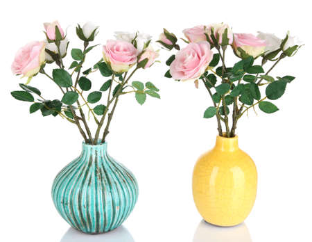 amorousness: Beautiful pink and white roses in vases isolated on white